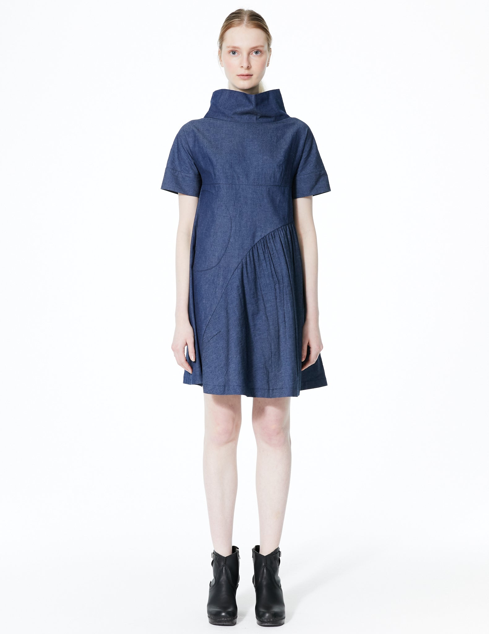 short a-line denim dress with high collar and curved gathered panel. made in new york city