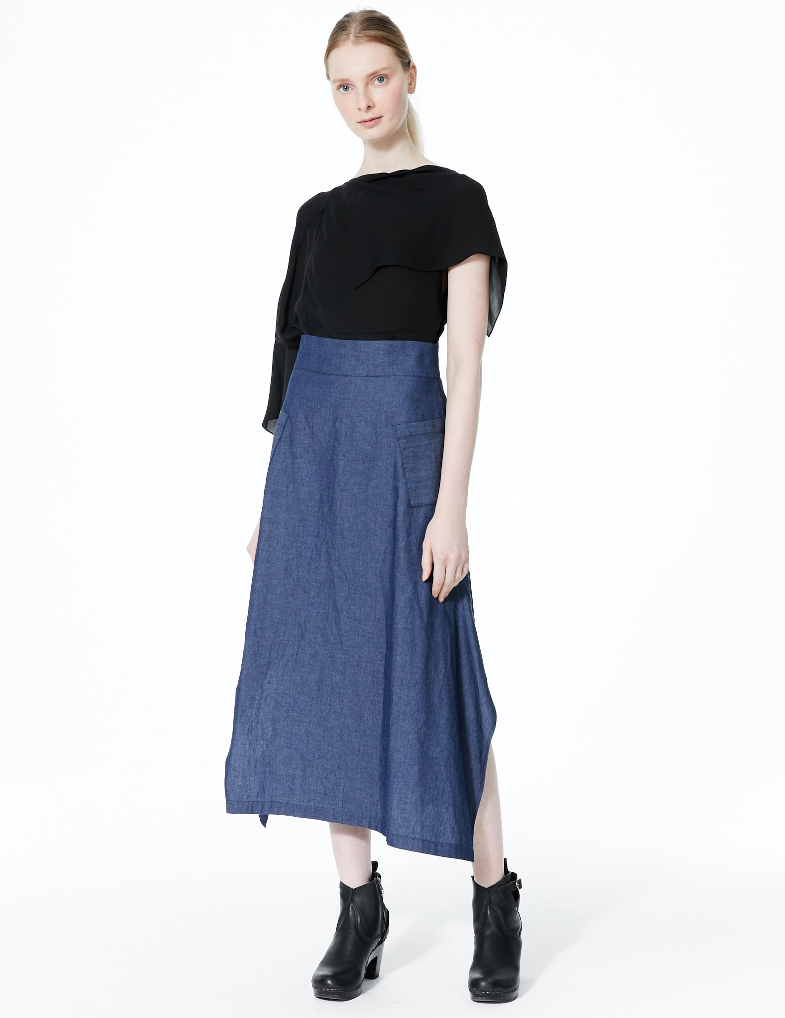 long fitted denim skirt with open side slits and pockets. made in new york city.