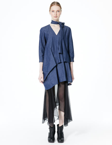 draped denim dress with self tie v-neckline. 3/4 length sleeves and curved pocket. made in new york city.