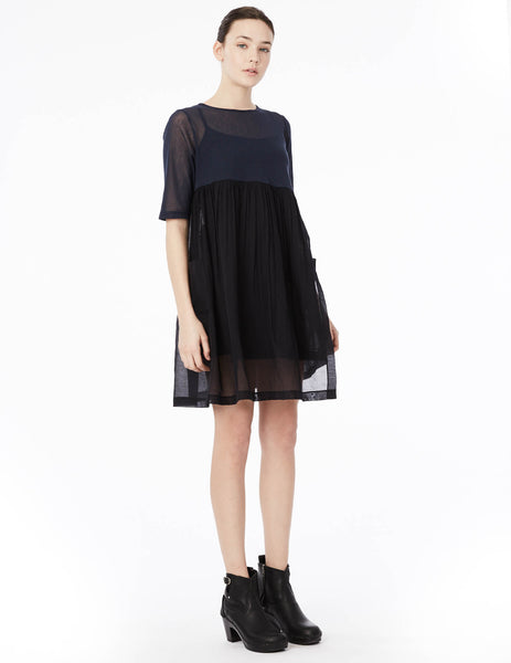 asymmetrically gathered dress with side button closure in cotton voile, with long sleeve yolk in cotton tulle