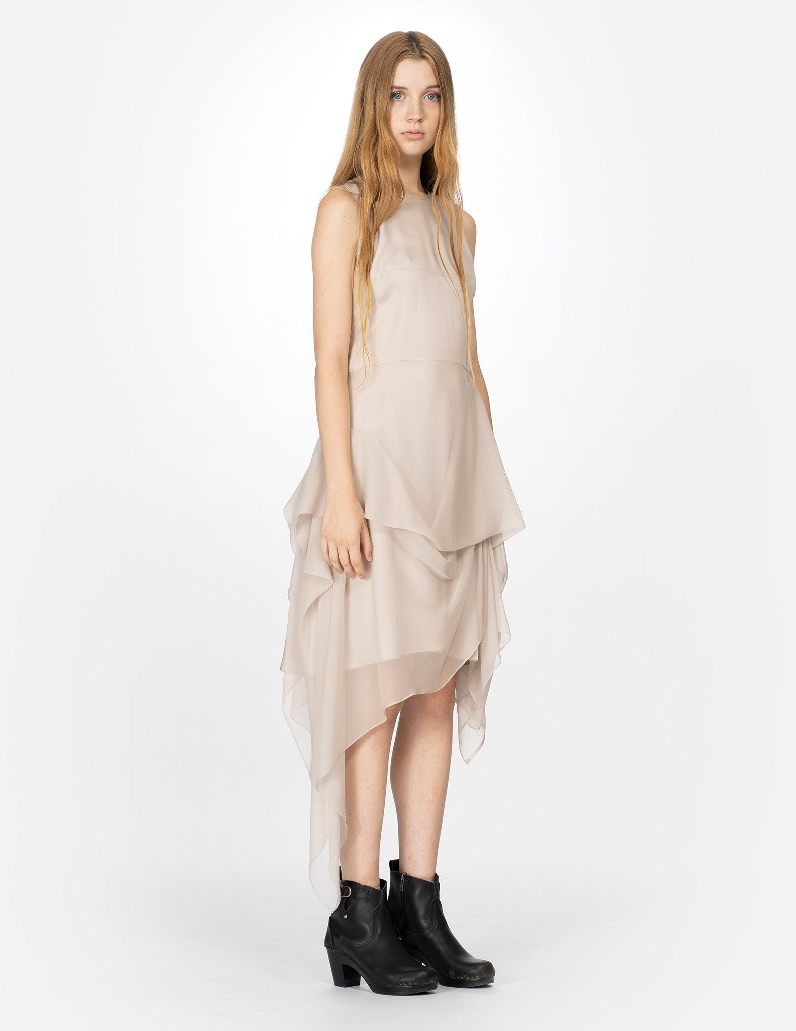 morgane le fay sleeveless silk chiffon dress with a draped skirt, crew neckline and waist tie. made in new york.