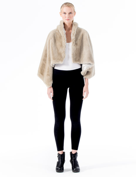 cropped faux fur poncho-like coat with oversized pin closure. made in new york city.