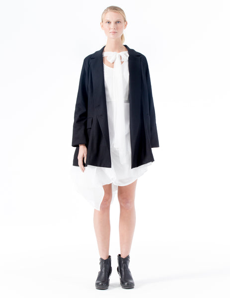 oversized blazer with lapels and flap pockets, and front double button closure. made in new york city.