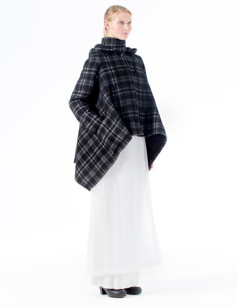 oversized plaid coat with high collar, front button closure, and longer sides. made in new york city.