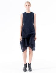 sleeveless, fitted dress with side gather detail at hip and oversized ruffle hem. back zipper closure. made in new york city.