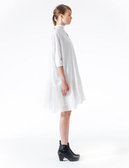a-line dress with neck-tie to open back and ruffled china silk hem. made in new york city.