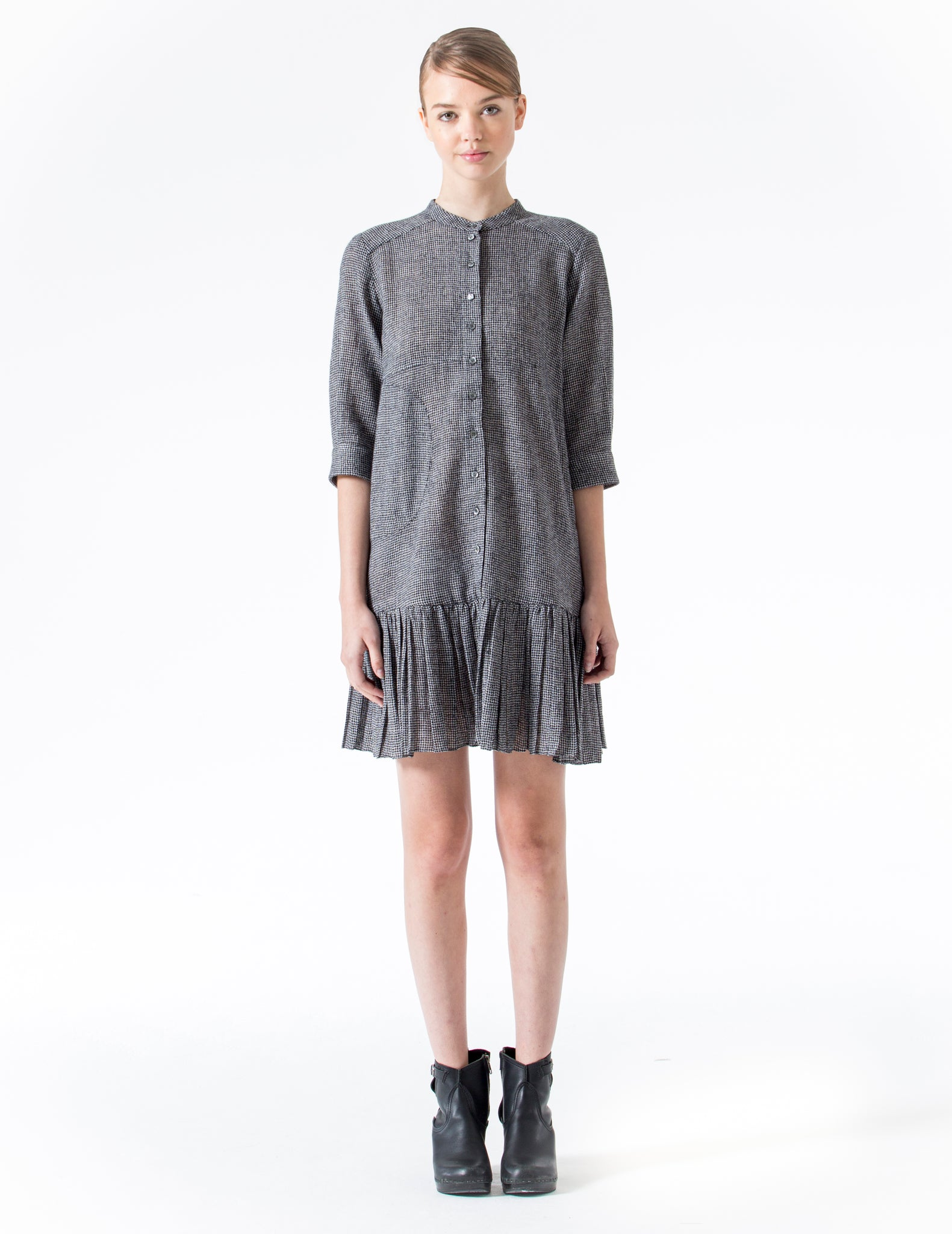 short dress with 3/4 length cuffed sleeves and ruffled hem. front button closure. made in new york city.