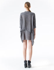 oversized 3/4 sleeve tunic with center front button closure, rounded pocket, and asymmetrical drapes. made in new york city.