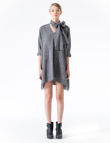 tunic with curved hem. 3/4 cuffed sleeves and v-neckline with self-tie bow at the neck. made in new york city.