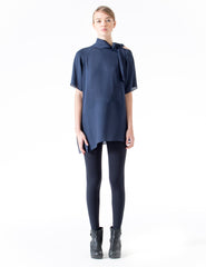 loose fitting double georgette blouse with neck-tie, short sleeves, and diagonal panel detail at hem. made in new york city.