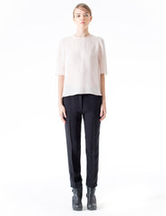 silk blouse with longer back, half-length sleeves and three-button closure at crew neck.