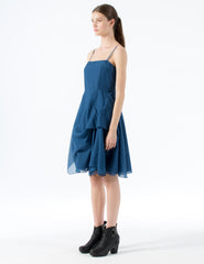 short fitted cotton voile dress with an open neckline, thin straps, and full, draped skirt. tie at waist. back zipper closure.
