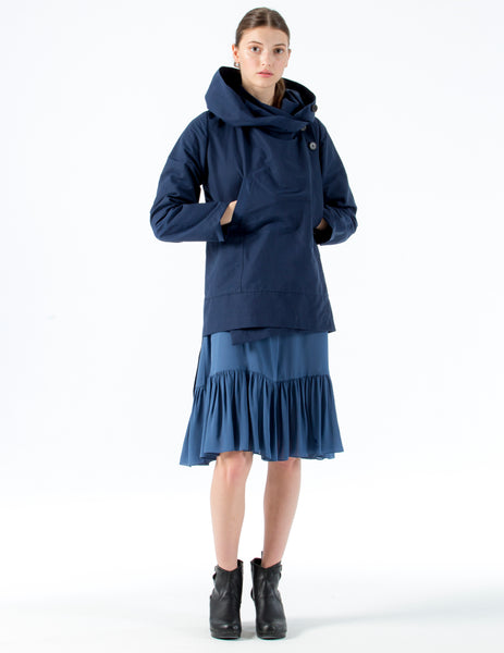 light-weight, oversized wrap raincoat with longer back panel and hood. side button closure.