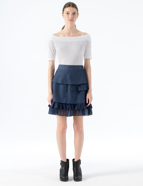 short denim skirt with gathered asymmetrical layers of cotton jersey and cotton tulle. single side pocket. side zipper and clasp closure with waistband