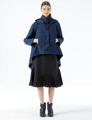 light-weight raincoat with cropped front, longer sides, and hood. front button closure.