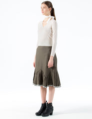 knee-length linen skirt with angular ruffle and selvage hem detail. back zipper closure.