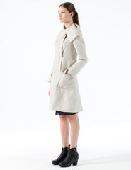 short, fitted linen jacket with oversized asymmetrical collar. side button closure.