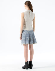 cropped linen vest with high collar and buckle side closure. back buttons at collar.