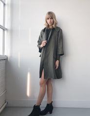 morgane le fay a-line coat with 3/4 sleeves and round collar. half lined. made in new york.