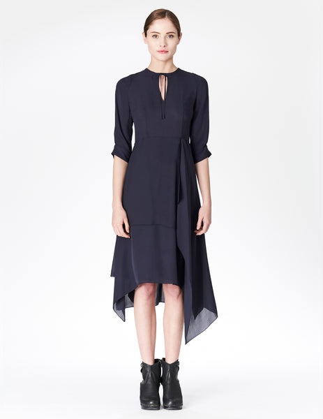 morgane le fay tea length dress with 3/4 sleeves, layered skirt, and key-hole neckline with tie. made in new york.