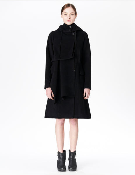 morgane le fay mid-length wool coat with offset button closure and front drape detail.