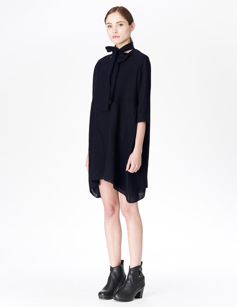 morgane le fay lined tunic dress with v-neckline with self-tie bow at neck.