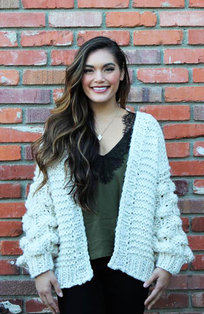 Hand Knit Pom Pom Cardigan In Ivory