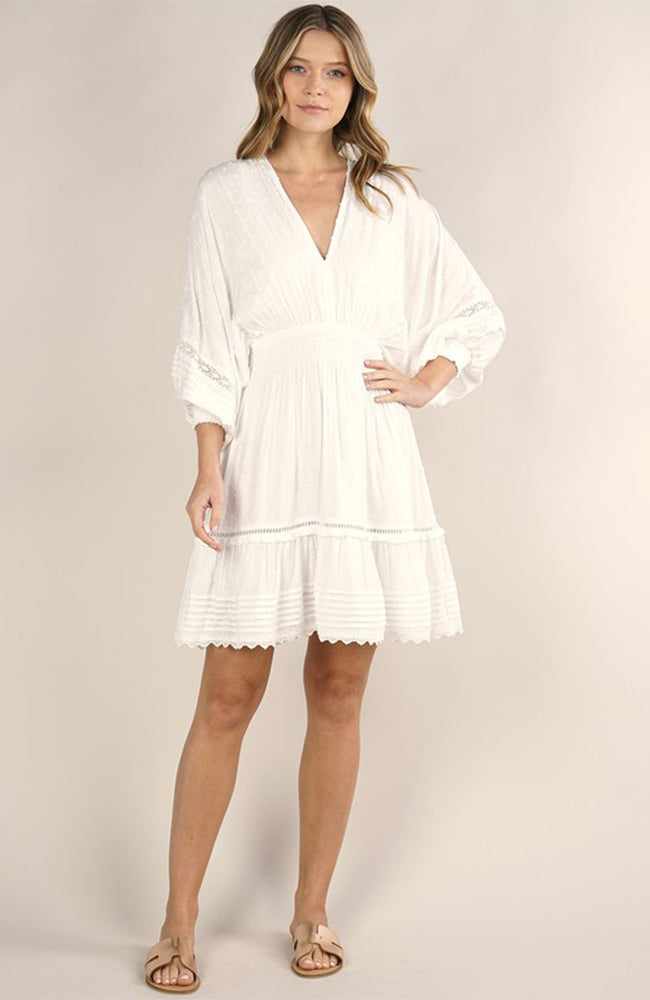 Lace trimmed off white mini dress by Love Stitch