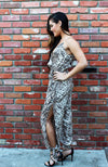 Beige Snakeskin Print Jumpsuit With Spaghetti Straps, Tie Waist, Side Slit Legs, And Ankle Ties