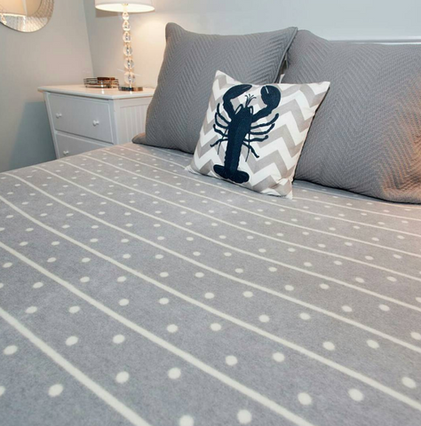 ChappyWrap how to style a blanket throw on a bed - gray polka dot blanket