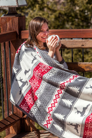 warm reindeer holiday blanket and throw by chappywrap