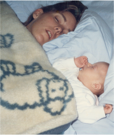 Beth, baby Christina, and the lamb blanket that started it all