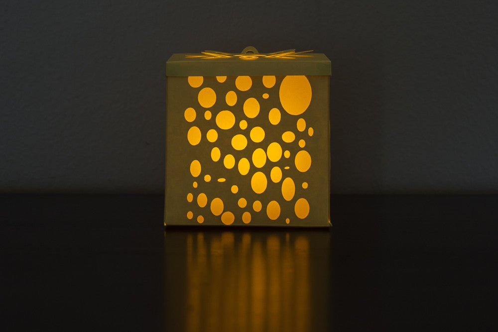 illuminated yellow bubbles candle holder