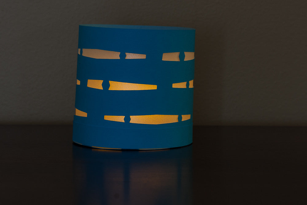 illuminated circular paper luminary blue with white waves