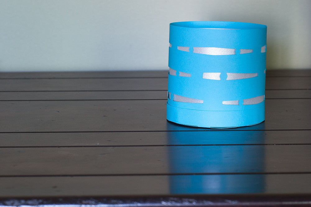 Circular paper luminary blue with white waves