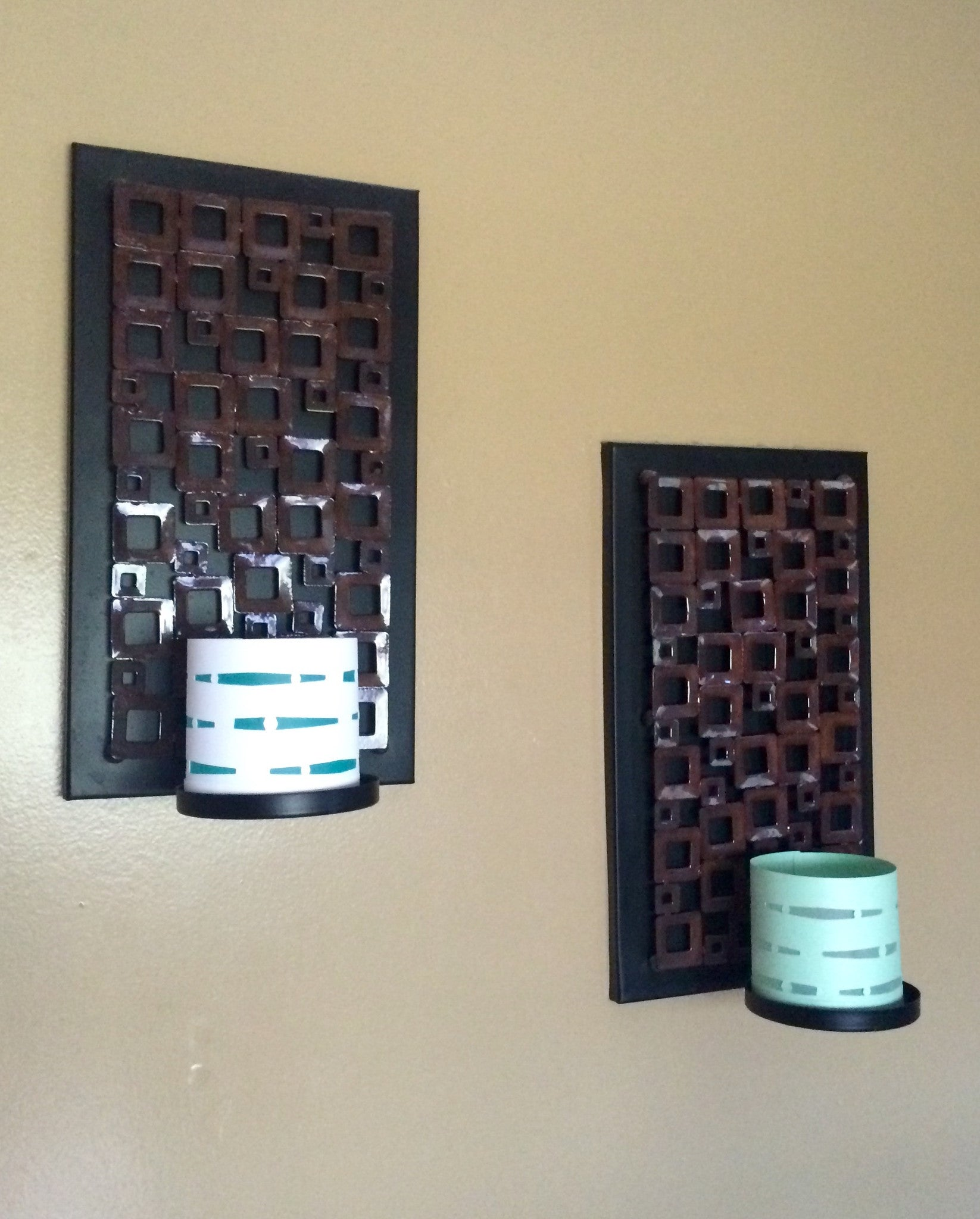 Wave candle holders hung on wall display industrial decor