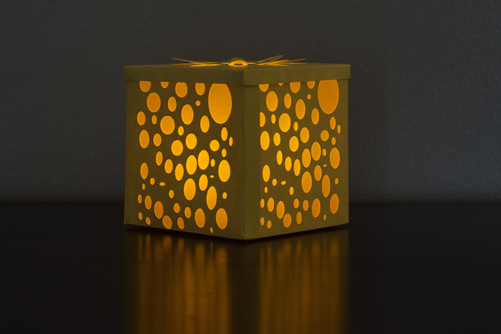 illuminated yellow paper candle holder