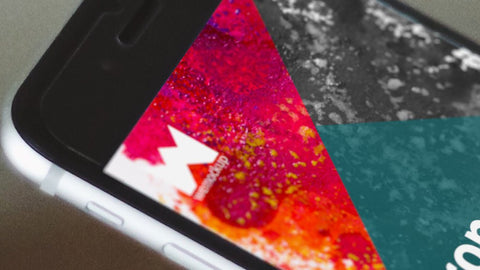 Iphone 6s Mockup Held In Hand Against Blurred Wooden Table Wemockup