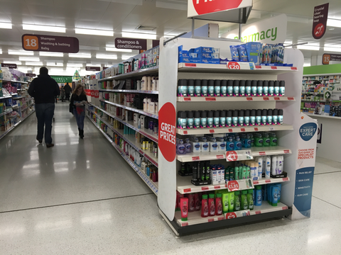 Deodorant cans arranged on end of shelf promotion mockup