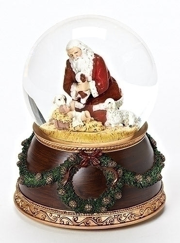 Kneeling Santa with Baby Jesus Music Snow Globe