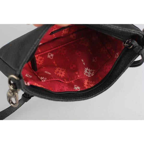small black leather crossbody with red tribal print lining