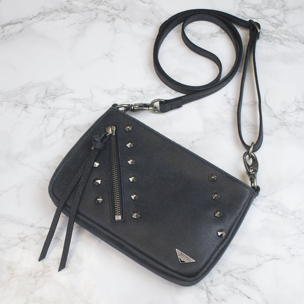 small black leather crossbody with studs
