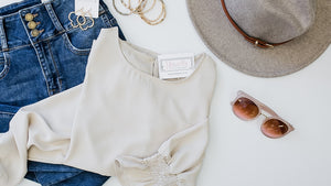 High waist jeans with long sleeve blouse.  Paired with blush sunglasses, gold tone earrings, stretch bracelets and wool feel fedora hat.