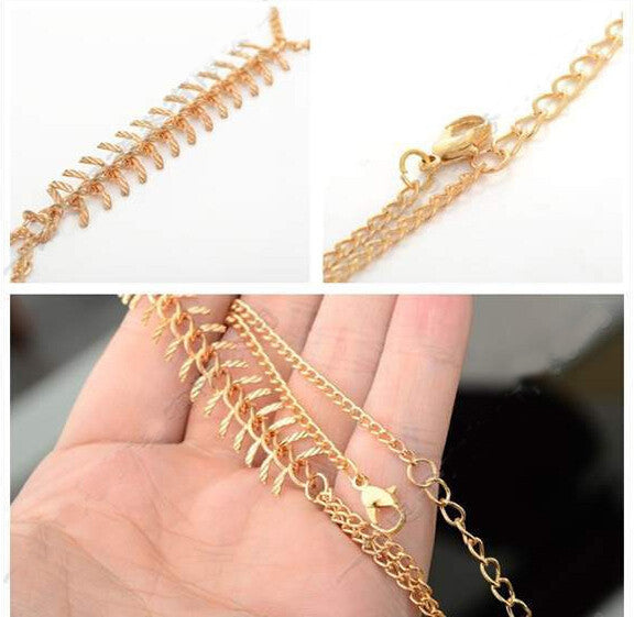 FISHTAIL bracelet with chain ring, gold