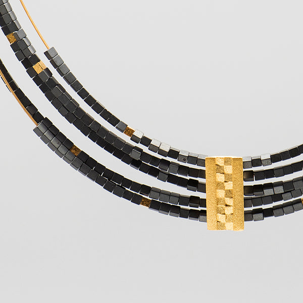 Bernd-Wolf-hematite-gold-plate-5-strand-necklace-kalled-gallery