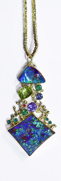 boulder opal peridot tanzanite emerald blue zircon ruby pendant 22k gold kalled
