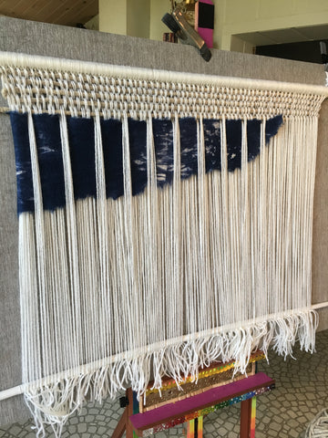 Batting weaving onto woven wall hanging