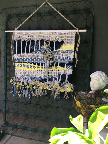 Woven wall hanging with shibori indigo dyed Fairfield batting, Orly-Fun lemon drop, recycled jeans, pompoms and tassels