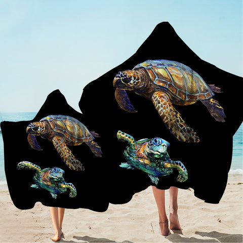 Sea Turtles in Black Hooded Towel