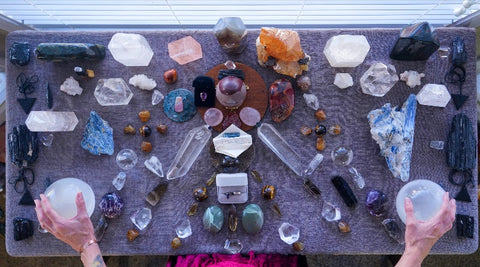 Crystals on Altar with hands holding Selenite Spheres